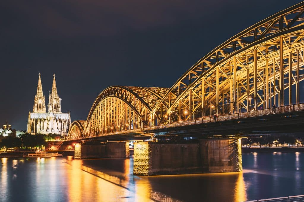 Cologne, Germany. Night View Of Cologne Cathedral And Hohenzollern Bridge. Gothic Cathedral In Dusk